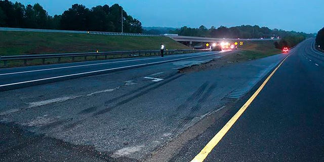Police said information from the scene indicates that a second vehicle may have been involved in the deadly crash. (Gwinnett County Police Department via AP)