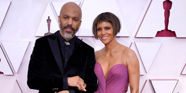 (L-R) Van Hunt and Halle Berry attend the 93rd Annual Academy Awards at Union Station on April 25, 2021 in Los Angeles, California.
