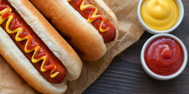 A company is offering to pay someone $  500 to taste and review hot dogs from MLB stadiums this year. (iStock)