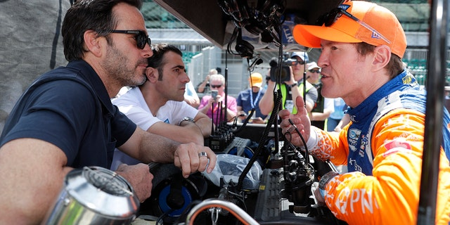 Jimmie Johnson speaks with Scott Dixon at practice for the 2019 Indy 500