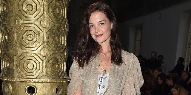 Katie Holmes previously dated Jamie Foxx and was married to Tom Cruise for five years before divorcing.