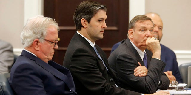 FILE - In this Dec. 5, 2016 file photo, defense attorneys Andy Savage, left, Don McCune, and Miller Shealy, right, sit around former North Charleston police officer Michael Slager at the Charleston County court in Charleston, S.C. (Grace Beahm/Post and Courier via AP, Pool)