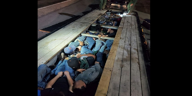 The Border Patrol says its Del Rio, Texas, sector discovered 20 people stuffed underneath the boards of a truck's trailer. (Border Patrol/Chief Patrol Agent Austin Skero)