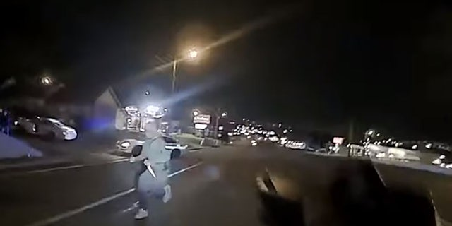 This screengrab taken from police body camera footage shows an unidentified man armed with at least one butcher knife running toward Officer Christopher Royer. (Metro Nashville Police Department)