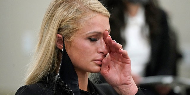 Paris Hilton wipes her eyes after speaking at a committee hearing at the Utah State Capitol, Lunedi, Feb. 8, 2021, in Salt Lake City.