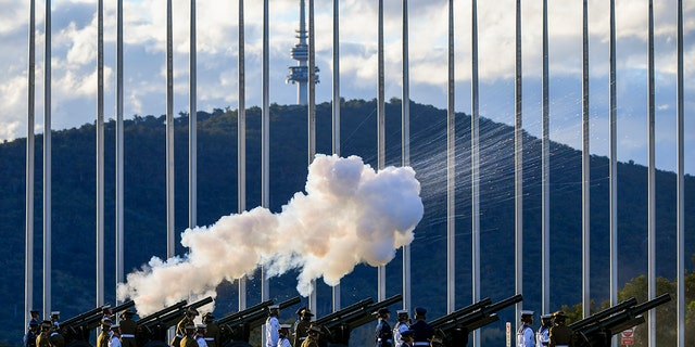 The Australian Federation Guard fire a 41 gun salute to mark the passing of Prince Philip on the forecourt of Parliament House, in Canberra, Australia, Saturday, April 10.