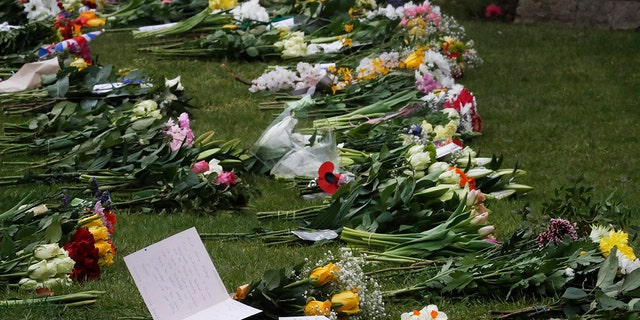 Floral tributes and notes left outside the gates of Windsor Castle, the day after the death of Britain's Prince Philip, in Windsor, England.