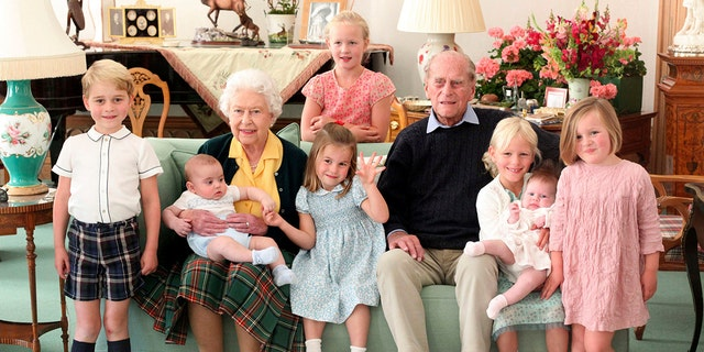 Duchess of Cambridge, Queen Elizabeth of England, Prince Philip and his great-grandchildren, from left: Prince George, Prince Louis, Savannah Phillips (standing behind), Princess Charlotte, Phillips Island offered this dateless Handout photos, and Mia Tindall. Elizabeth II's mysterious and tough husband, Prince Phillip of England, who spent more than 70 years helping his wife in a role that almost defined his wife's life, died on Friday, April 9, 2021. ..