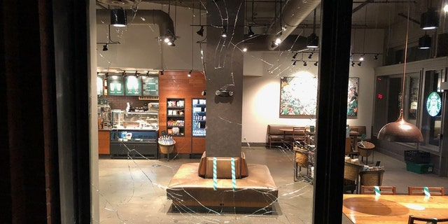 Rioters smashed the window of a Starbucks in Portland Friday night.