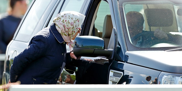 Prince Philip speaks to Queen Elizabeth II in 2018 from the Land Rover Freelander he would be involved in an accident with the following year.