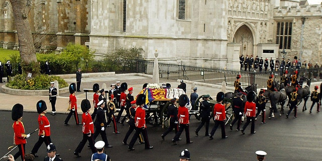 Queen Elizabeth The Queen Mother's coffin was carried to Westminster Abbey for her funeral ceremony in 2002 on the back of a horse-drawn gun carriage