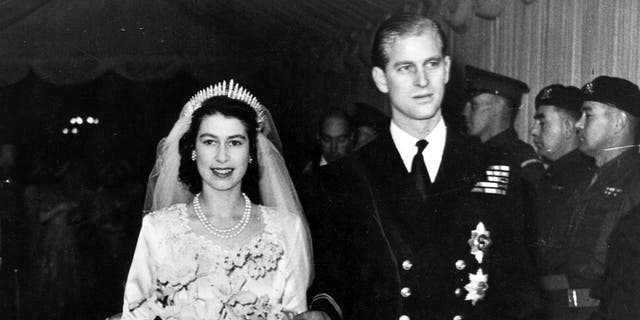 Queen Elizabeth II, as Princess Elizabeth, and her husband the Duke of Edinburgh, styled Prince Philip in 1957, on their wedding day. She became queen on her father King George VI's death in 1952. Philip died Friday at the age of 99.