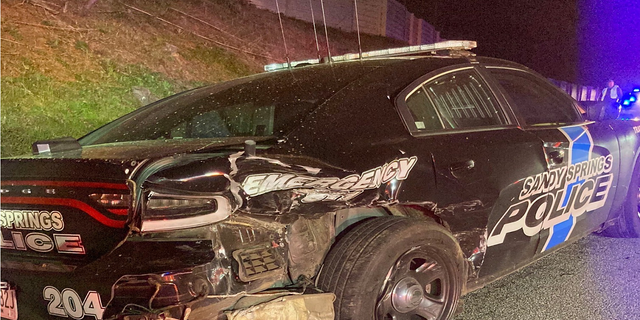 The damaged patrol car following the collision. (Sandy Springs Police Department)