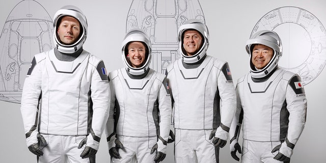 This March 3, 2021 photo made available by SpaceX shows mission specialist Thomas Pesquet of the European Space Agency, pilot Megan McArthur and commander Shane Kimbrough of NASA, and mission specialist Akihiko Hoshide of the Japan Aerospace Exploration Agency, the crew for its third astronaut launch to the International Space Station, at the SpaceX training facility in Hawthorne, Calif. (SpaceX via AP)