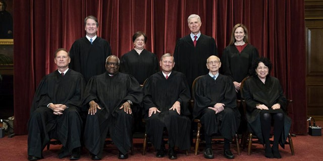 In this April 23, 2021, file photo members of the Supreme Court pose for a group photo at the Supreme Court in Washington. Seated from left are Associate Justice Samuel Alito, Associate Justice Clarence Thomas, Chief Justice John Roberts, Associate Justice Stephen Breyer and Associate Justice Sonia Sotomayor, Standing from left are Associate Justice Brett Kavanaugh, Associate Justice Elena Kagan, Associate Justice Neil Gorsuch and Associate Justice Amy Coney Barrett. Before the Supreme Court this is week is an argument over whether public schools can discipline students over something they say off-campus. (Erin Schaff/The New York Times via AP, Pool, File