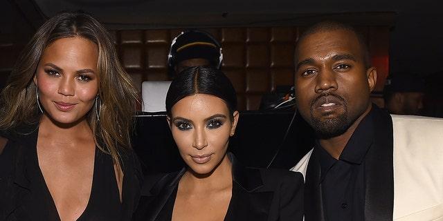 (L-R) Chrissy Teigen says Kim Kardashian tried her best in her marriage to Kanye West.