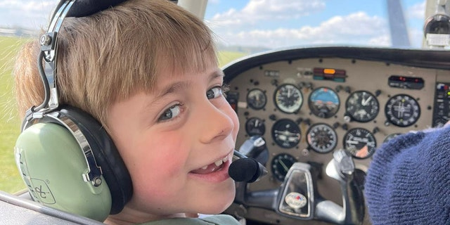 Pint-sized Jacob Newson, who dreams of becoming a RAF pilot, took his first flying lesson. (SWNS).