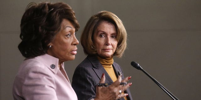 House Speaker Nancy Pelosi looks on as Rep. Maxine Waters speaks at a news conference criticizing then-President Trump's Wall Street policies on Capitol Hill on Feb. 6, 2017. (Mario Tama/Getty Images)