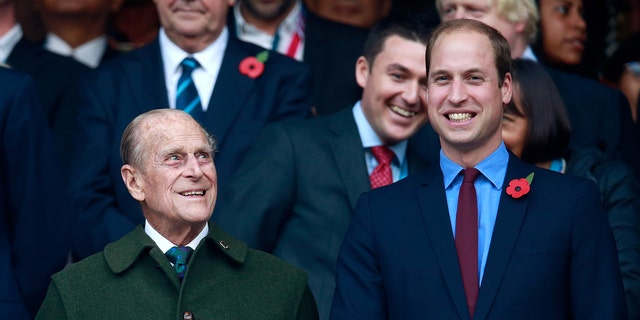 Prince Phillip (L) and Prince William (R) enjoy the build up to the 2015 Rugby World Cup Final match between New Zealand and Australia at Twickenham Stadium.