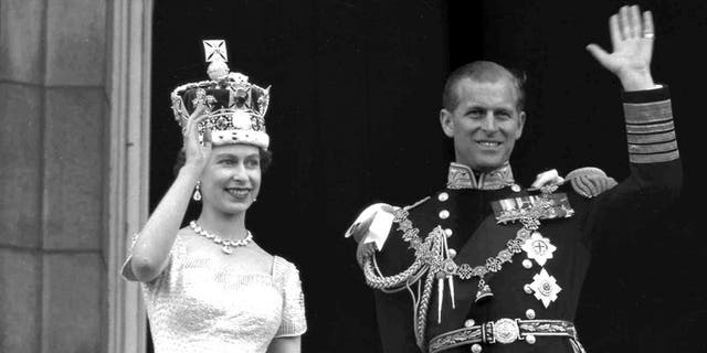 In this June 2, 1953 file photo, Britain's Queen Elizabeth II and her husband, the Duke of Edinburgh, wave from the balcony of Buckingham Palace, London, following the Queen's coronation at Westminster Abbey. Buckingham Palace confirmed Philip's death at the age of 99 last Friday.