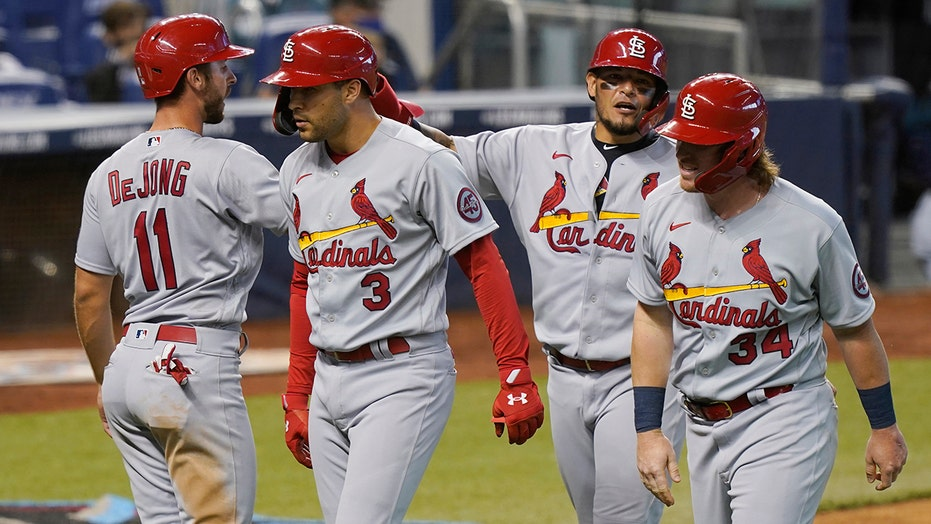 Molina HR, Carlson slam lead Cards over Marlins 7-0 & sweep