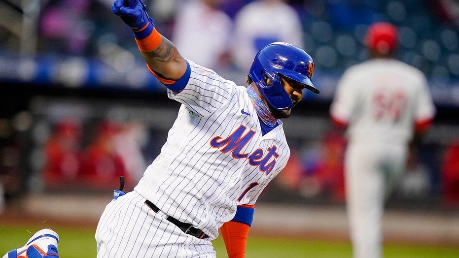 Mets win doubleheader opener, edge Phillies 4-3 in extras