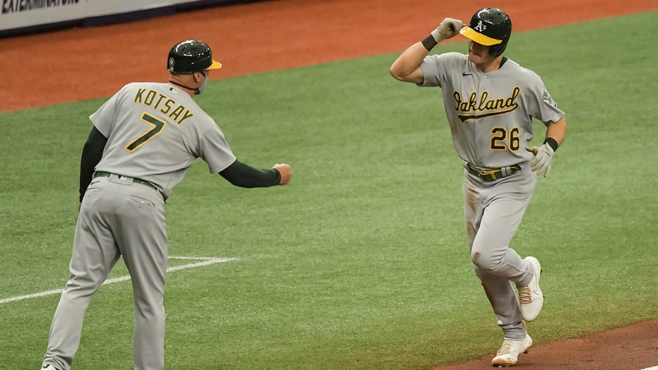 Chapman leads A's over Rays 3-2 in McClanahan's debut