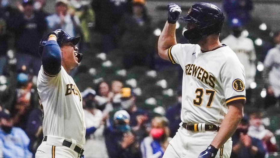 Houser hits 1st HR, pitches Brewers past Marlins 5-4