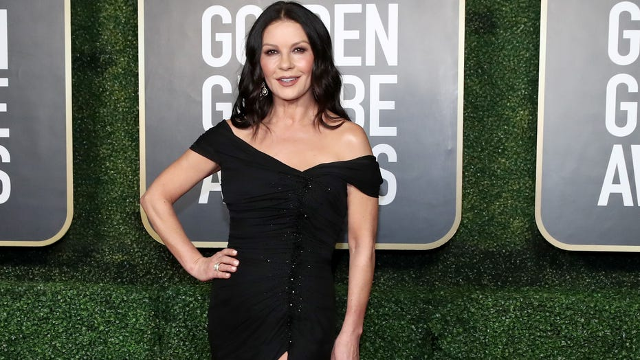 Catherine Zeta-Jones turns her closet into a runway as she struts to Madonna's 'Vogue'