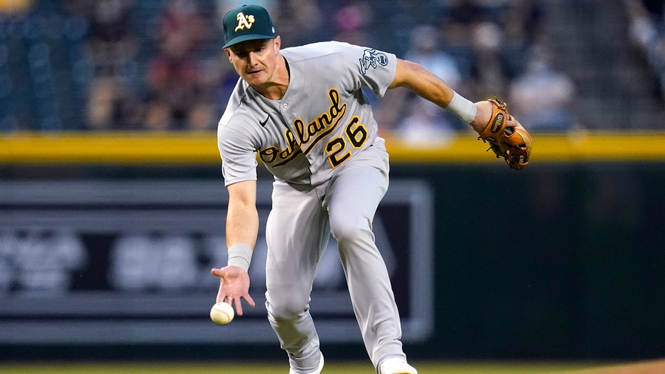 Chapman homers, A's beat MadBum and Diamondbacks 9-5