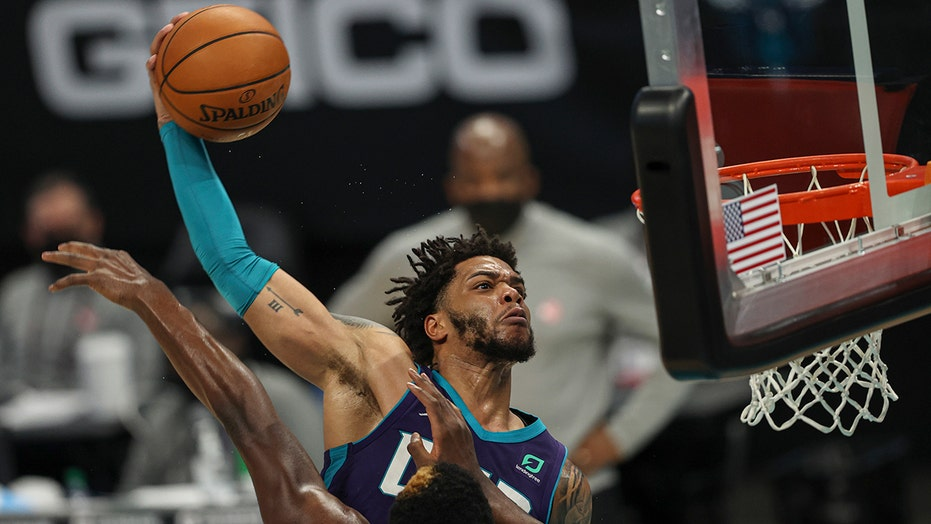 Hornets' Miles Bridges throws down vicious dunk on Hawks defender