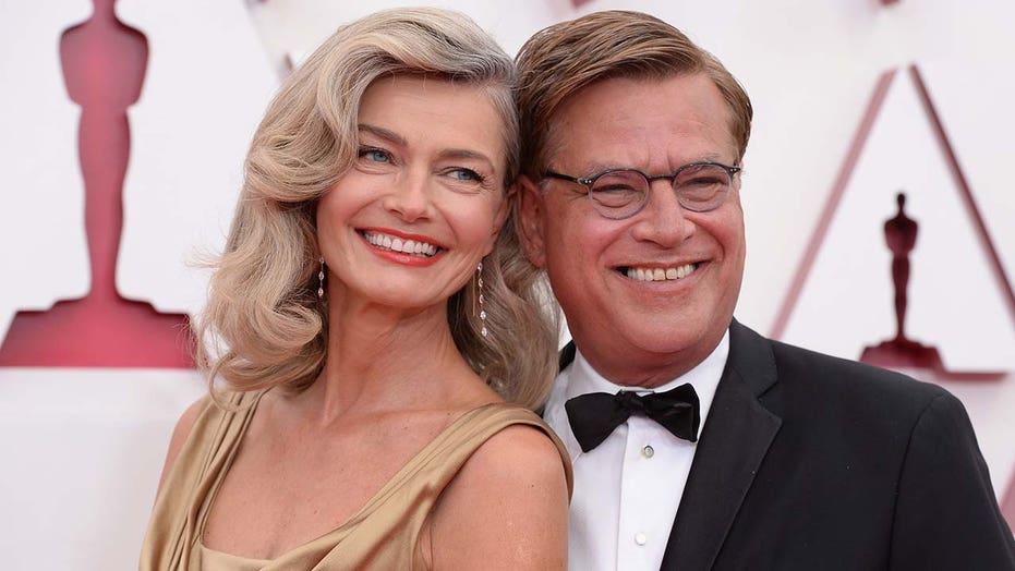 Paulina Porizkova jokes she was a 'female Oscar' for boyfriend Aaron Sorkin in 15-year-old gold gown at show