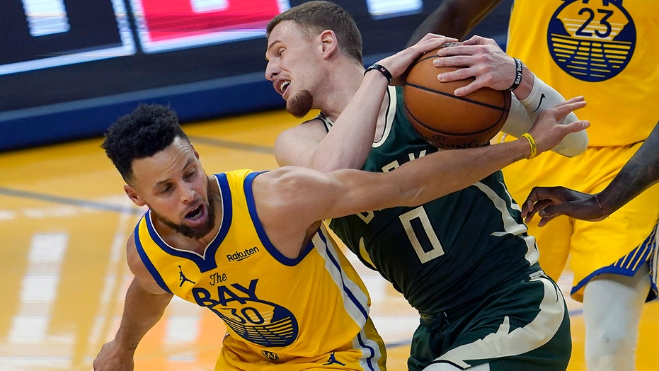 Kerrie, Warriors use furious finish to hold off Bucks 122-121