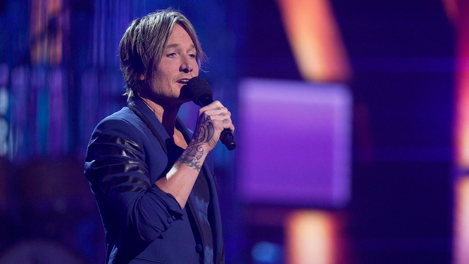 Keith Urban shows off new tribal tattoo at 2021 ACM Awards
