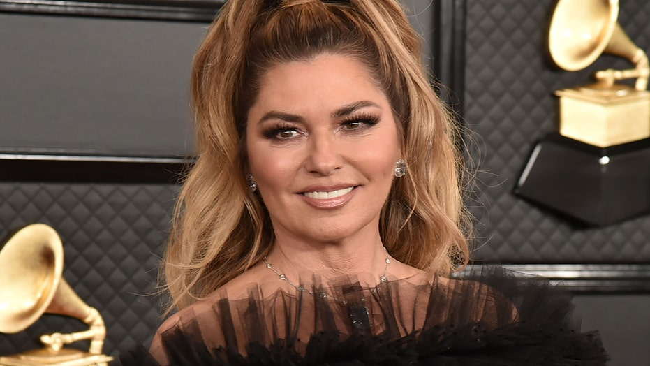 Shania Twain models mini dress from 'Man! I Feel Like a Woman' music video: 'Same outfit, 20 years apart!'
