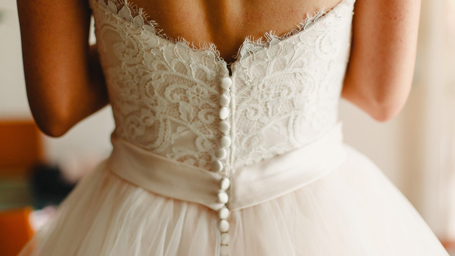 Baltimore bride wears wedding reception dress to get COVID-19 vaccine