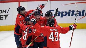 Capitals beat Flyers in overtime, Penguins win East Division