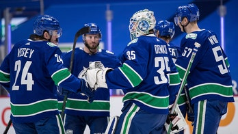 Demko makes 38 saves and Canucks top Flames 4-2