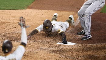 Padres score on wild pitch to beat Rockies 2-1 in 10 innings