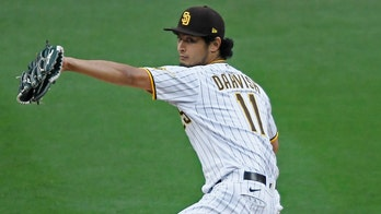 Darvish fans 10 and doubles, Machado HR, Padres beat Rockies