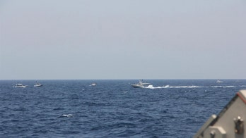 US warships fire warning shots at Iranian gunboats in the Strait of Hormuz