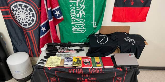 A search warrant was executed at Blevins' residence in the 200 block of Spence Street for seizure of firearms, ammunition, electronic evidence, concentrated THC, and radical ideology paraphernalia, including books, flags, and handwritten documents. (Photo courtesy of Kerr County Sheriff's Office)