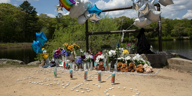A memorial at Waldo Lake in D.W. Field Park on Monday, May 17, 2021 has grown since Sunday in memory of two Brockton boys who drowned Saturday night. (Alyssa Stone-USA TODAY NETWORK)