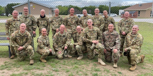 Soldiers from the 1st Battalion, 171st General Support Aviation Battalion, shaved their heads and posed for a photo in North Fort Hood, Texas before being dispatched to the Middle East with Task Force Phoenix.  They shaved their heads in support of Staff Sgt. Brandon Stafford's sister, who underwent chemotherapy and radiation after a brain tumor had been removed.  (U.S. Army National Guard photo by 1st Lt. Luke Legrand)