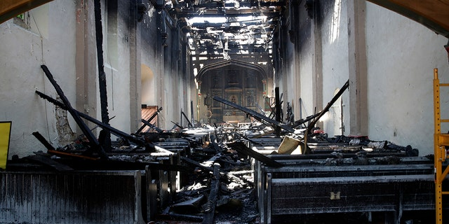The interior of the San Gabriel Mission is damaged following a morning fire, Saturday, July 11, 2020, in San Gabriel, Calif. (Associated Press)
