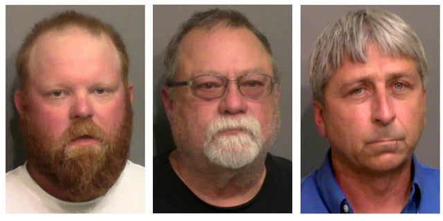 """This combo of booking photos provided by the Glynn County, Ga., Detention Center, shows from left, Travis McMichael, his father Gregory McMichael, and William """"Roddie"""" Bryan Jr. (Glynn County Detention Center via AP)"""