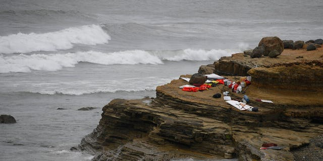 Items from a boat sit on the shoreline at Cabrillo National Monument near where it capsized just off the San Diego coast Sunday, May 2, 2021, in San Diego.
