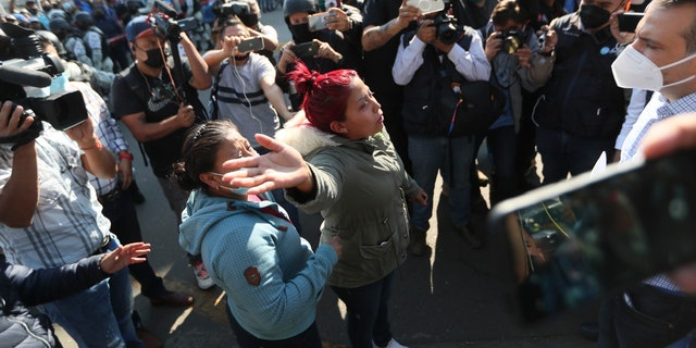 A woman demands information from a lawmaker of people injured when a metro overpass collapsed, near the site of the wreckage in Mexico City, Tuesday, May 4, 2021. (AP Photo/Fernando Llano)