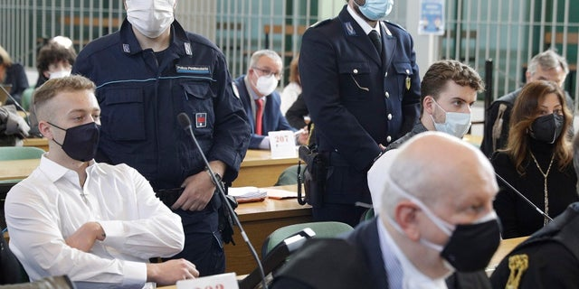 Finnegan Lee Elder, left, and co-defendant Gabriel Natale-Hjorth, right, sit Wednesday before a jury began deliberating their fate in the trial for the slaying of an Italian plainclothes police officer on a street near the hotel where they were staying while on vacation in Rome in summer 2019, in Rome. (AP Photo/Gregorio Borgia)