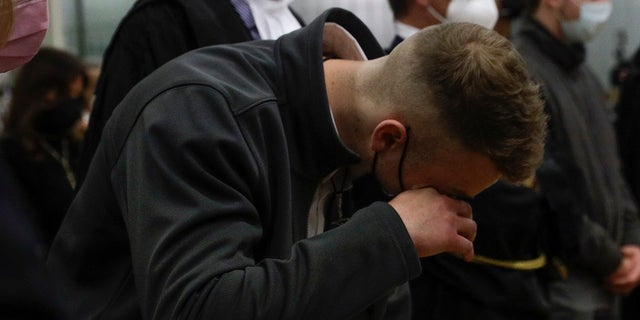 Finnegan Lee Elder wipes a tear Wednesday as he listens as the verdict is read, in the trial for the slaying of an Italian plainclothes police officer in summer 2019, in Rome. A jury in Rome convicted two American friends in the 2019 slaying of a police officer in a drug sting gone awry, sentencing them to life in prison. The jury deliberated more than 12 hours before delivering the verdicts against Finnegan Lee Elder, 21, and Gabriel Natale Hjorth, 20, handing them Italy's stiffest sentence. (AP Photo/Gregorio Borgia)
